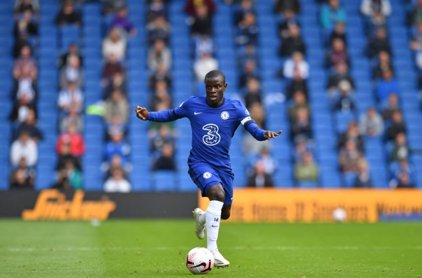 Chelsea's French midfielder N'Golo Kante runs with the ball as socially distanced fans watch from the stands during the pre-season friendly football match between Brighton and Hove Albion and Chelsea at the American Express Community Stadium in Brighton, southern England on August 29, 2020. - The game is a 'pilot' event where a small number of fans will be present on a socially-distanced basis. The aim is to get fans back into stadiums in the Premier League by October. (Photo by Glyn KIRK / AFP) (Photo by GLYN KIRK/AFP via Getty Images)