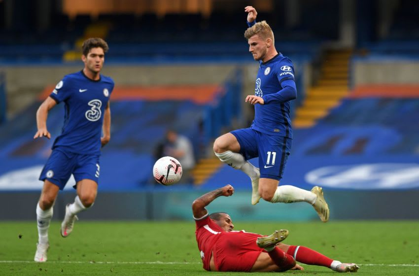 Chelsea's German striker Timo Werner jumps over a challenge from Liverpool's Spanish midfielder Thiago Alcantara during the English Premier League football match between Chelsea and Liverpool at Stamford Bridge in London on September 20, 2020. (Photo by NEIL HALL / POOL / AFP) / RESTRICTED TO EDITORIAL USE. No use with unauthorized audio, video, data, fixture lists, club/league logos or 'live' services. Online in-match use limited to 120 images. An additional 40 images may be used in extra time. No video emulation. Social media in-match use limited to 120 images. An additional 40 images may be used in extra time. No use in betting publications, games or single club/league/player publications. / (Photo by NEIL HALL/POOL/AFP via Getty Images)