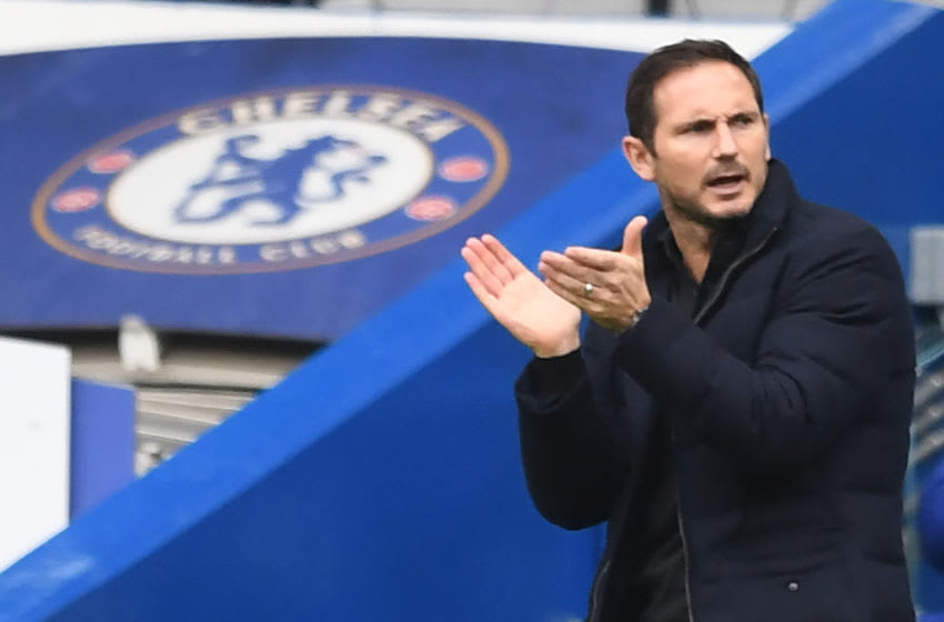 Chelsea's English head coach Frank Lampard gestures during the English Premier League football match between Chelsea and Crystal Palace at Stamford Bridge in London on October 3, 2020. (Photo by NEIL HALL / POOL / AFP) / RESTRICTED TO EDITORIAL USE. No use with unauthorized audio, video, data, fixture lists, club/league logos or 'live' services. Online in-match use limited to 120 images. An additional 40 images may be used in extra time. No video emulation. Social media in-match use limited to 120 images. An additional 40 images may be used in extra time. No use in betting publications, games or single club/league/player publications. / (Photo by NEIL HALL/POOL/AFP via Getty Images)