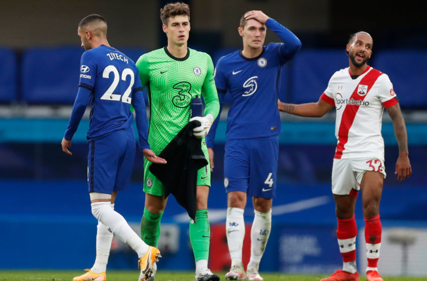 Chelsea's Danish defender Andreas Christensen (2nd R) reacts beside Southampton's English striker Theo Walcott (R) and Chelsea's Spanish goalkeeper Kepa Arrizabalaga (2nd L) as Chelsea's Moroccan midfielder Hakim Ziyech walks past after the English Premier League football match between Chelsea and Southampton at Stamford Bridge in London on October 17, 2020. (Photo by MATTHEW CHILDS / POOL / AFP) / RESTRICTED TO EDITORIAL USE. No use with unauthorized audio, video, data, fixture lists, club/league logos or 'live' services. Online in-match use limited to 120 images. An additional 40 images may be used in extra time. No video emulation. Social media in-match use limited to 120 images. An additional 40 images may be used in extra time. No use in betting publications, games or single club/league/player publications. / (Photo by MATTHEW CHILDS/POOL/AFP via Getty Images)