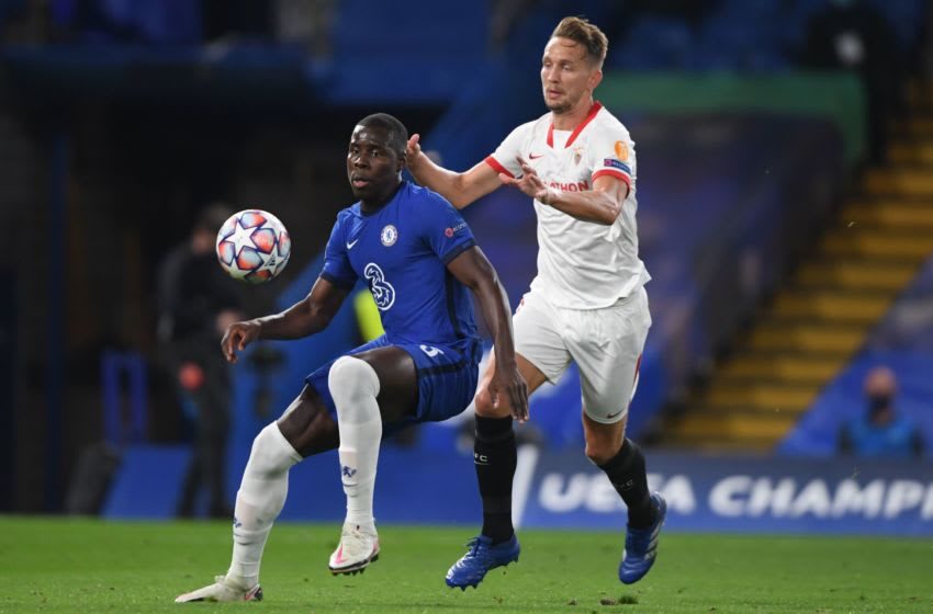 Chelsea's French defender Kurt Zouma (L) vies with Sevilla's Dutch forward Luuk De Jong during the UEFA Champions League first round Group E football match between Chelsea and Sevilla at Stamford Bridge in London on October 20, 2020. (Photo by Mike Hewitt / POOL / AFP) (Photo by MIKE HEWITT/POOL/AFP via Getty Images)