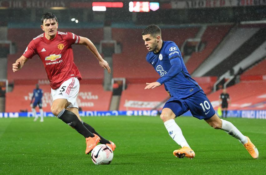 Manchester United's English defender Harry Maguire (L) vies with Chelsea's US midfielder Christian Pulisic during the English Premier League football match between Manchester United and Chelsea at Old Trafford in Manchester, north west England, on October 24, 2020. (Photo by Michael Regan / POOL / AFP) / RESTRICTED TO EDITORIAL USE. No use with unauthorized audio, video, data, fixture lists, club/league logos or 'live' services. Online in-match use limited to 120 images. An additional 40 images may be used in extra time. No video emulation. Social media in-match use limited to 120 images. An additional 40 images may be used in extra time. No use in betting publications, games or single club/league/player publications. / (Photo by MICHAEL REGAN/POOL/AFP via Getty Images)