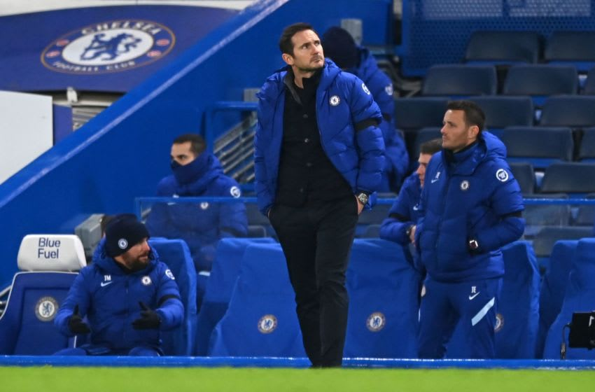 Chelsea's English head coach Frank Lampard looks on from the sidelines during the English Premier League football match between Chelsea and Manchester City at Stamford Bridge in London on January 3, 2021. - Manchester City won the game 3-1. (Photo by Shaun Botterill / POOL / AFP) / RESTRICTED TO EDITORIAL USE. No use with unauthorized audio, video, data, fixture lists, club/league logos or 'live' services. Online in-match use limited to 120 images. An additional 40 images may be used in extra time. No video emulation. Social media in-match use limited to 120 images. An additional 40 images may be used in extra time. No use in betting publications, games or single club/league/player publications. / (Photo by SHAUN BOTTERILL/POOL/AFP via Getty Images)