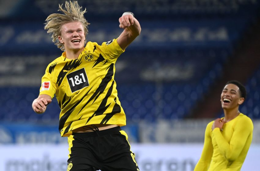 Dortmund's Norwegian forward Erling Braut Haaland (L) celebrates with Dortmund's English midfielder Jude Bellingham after the German first division Bundesliga football match FC Schalke 04 vs Borussia Dortmund in Gelsenkirchen, western Germany, on February 20, 2021. - Dortmund won the match 4-0. (Photo by Ina Fassbender / various sources / AFP) / RESTRICTIONS: DFL REGULATIONS PROHIBIT ANY USE OF PHOTOGRAPHS AS IMAGE SEQUENCES AND/OR QUASI-VIDEO (Photo by INA FASSBENDER/AFP via Getty Images)