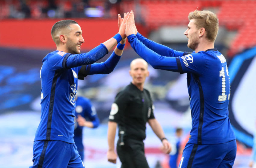 Chelsea's Moroccan midfielder Hakim Ziyech (L) celebrates with Chelsea's German striker Timo Werner (R) after scoring the opening goal of the English FA Cup semi-final football match between Chelsea and Manchester City at Wembley Stadium in north west London on April 17, 2021. - Chelsea won the game 1-0. - RESTRICTED TO EDITORIAL USE. No use with unauthorized audio, video, data, fixture lists, club/league logos or 'live' services. Online in-match use limited to 120 images. An additional 40 images may be used in extra time. No video emulation. Social media in-match use limited to 120 images. An additional 40 images may be used in extra time. No use in betting publications, games or single club/league/player publications. (Photo by Adam Davy / POOL / AFP) / RESTRICTED TO EDITORIAL USE. No use with unauthorized audio, video, data, fixture lists, club/league logos or 'live' services. Online in-match use limited to 120 images. An additional 40 images may be used in extra time. No video emulation. Social media in-match use limited to 120 images. An additional 40 images may be used in extra time. No use in betting publications, games or single club/league/player publications. / RESTRICTED TO EDITORIAL USE. No use with unauthorized audio, video, data, fixture lists, club/league logos or 'live' services. Online in-match use limited to 120 images. An additional 40 images may be used in extra time. No video emulation. Social media in-match use limited to 120 images. An additional 40 images may be used in extra time. No use in betting publications, games or single club/league/player publications. (Photo by ADAM DAVY/POOL/AFP via Getty Images)