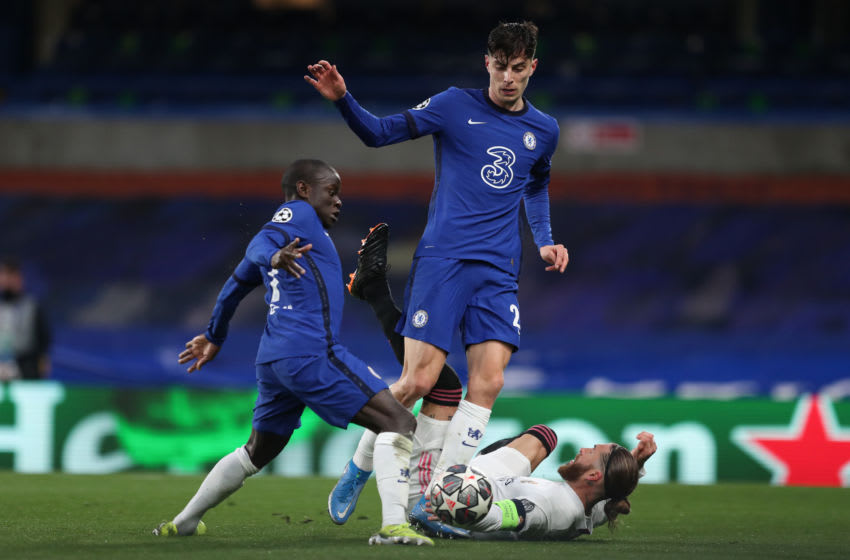 LONDON, ENGLAND - MAY 05: Ngolo Kante and Kai Havertz of Chelsea battle for the ball with Sergio Ramos of Real Madrid during the UEFA Champions League Semi Final Second Leg match between Chelsea and Real Madrid at Stamford Bridge on May 5, 2021 in London, United Kingdom. Sporting stadiums around Europe remain under strict restrictions due to the Coronavirus Pandemic as Government social distancing laws prohibit fans inside venues resulting in games being played behind closed doors. (Photo by James Williamson - AMA/Getty Images)