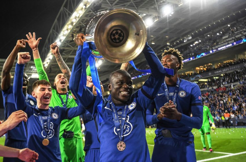 TOPSHOT - Chelsea's French midfielder N'Golo Kante (C) lifts the trophy after winning the UEFA Champions League final football match between Manchester City and Chelsea FC at the Dragao stadium in Porto on May 29, 2021. (Photo by David Ramos / POOL / AFP) (Photo by DAVID RAMOS/POOL/AFP via Getty Images)