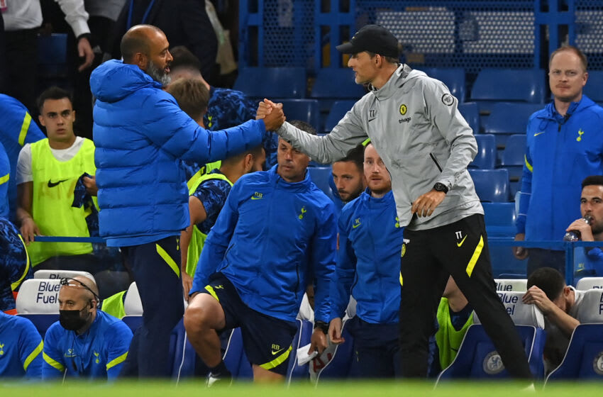 Tottenham Hotspur's Portuguese Head Coach Nuno Espirito Santo (L) shakes hamds with Chelsea's German head coach Thomas Tuchel (R) after the pre-season friendly football match between Chelsea and Tottenham Hotspur at Stamford Bridge in London on August 4, 2021. - The game finished 2-2. - RESTRICTED TO EDITORIAL USE. No use with unauthorized audio, video, data, fixture lists, club/league logos or 'live' services. Online in-match use limited to 75 images, no video emulation. No use in betting, games or single club/league/player publications. (Photo by Glyn KIRK / AFP) / RESTRICTED TO EDITORIAL USE. No use with unauthorized audio, video, data, fixture lists, club/league logos or 'live' services. Online in-match use limited to 75 images, no video emulation. No use in betting, games or single club/league/player publications. / RESTRICTED TO EDITORIAL USE. No use with unauthorized audio, video, data, fixture lists, club/league logos or 'live' services. Online in-match use limited to 75 images, no video emulation. No use in betting, games or single club/league/player publications. (Photo by GLYN KIRK/AFP via Getty Images)
