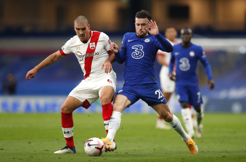 LONDON, ENGLAND - OCTOBER 17: Oriol Romeu of Southampton battles for possession with Ben Chilwell of Chelsea during the Premier League match between Chelsea and Southampton at Stamford Bridge on October 17, 2020 in London, England. Sporting stadiums around the UK remain under strict restrictions due to the Coronavirus Pandemic as Government social distancing laws prohibit fans inside venues resulting in games being played behind closed doors. (Photo by Matthew Childs - Pool/Getty Images)
