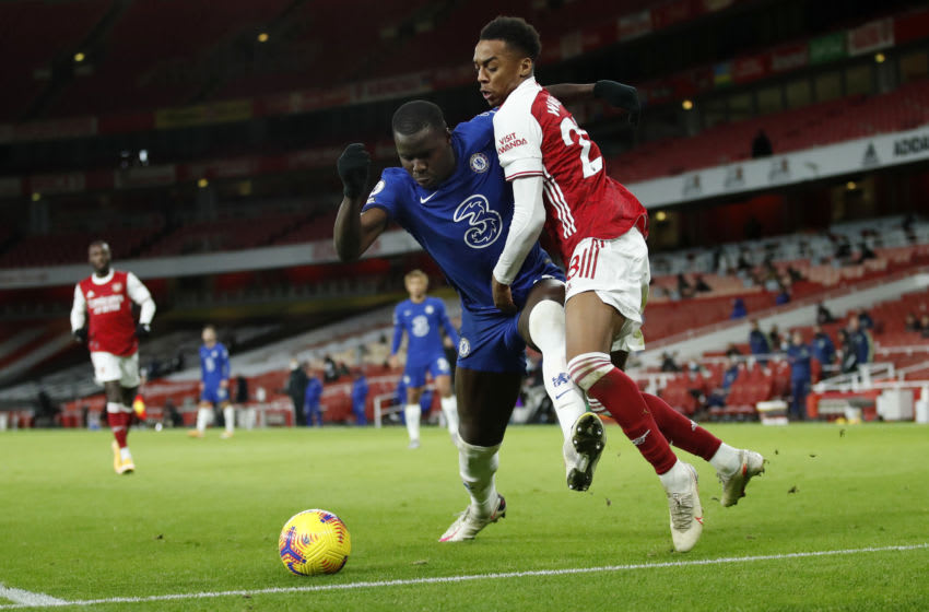 LONDON, ENGLAND - DECEMBER 26: Kurt Zouma of Chelsea holds off Joe Willock of Arsenal during the Premier League match between Arsenal and Chelsea at Emirates Stadium on December 26, 2020 in London, England. The match will be played without fans, behind closed doors as a Covid-19 precaution. (Photo by Andrew Boyers - Pool/Getty Images)