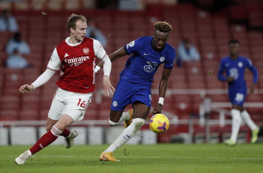 LONDON, ENGLAND - DECEMBER 26: Tammy Abraham of Chelsea is challenged by Rob Holding of Arsenal during the Premier League match between Arsenal and Chelsea at Emirates Stadium on December 26, 2020 in London, England. The match will be played without fans, behind closed doors as a Covid-19 precaution. (Photo by Adrian Dennis - Pool/Getty Images)