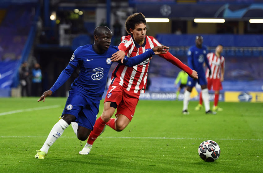 LONDON, ENGLAND - MARCH 17: Ngolo Kante of Chelsea and Joao Felix of Atletico Madrid battle for the ball during the UEFA Champions League Round of 16 match between Chelsea FC and Atletico Madrid at Stamford Bridge on March 17, 2021 in London, England. Sporting stadiums around the UK remain under strict restrictions due to the Coronavirus Pandemic as Government social distancing laws prohibit fans inside venues resulting in games being played behind closed doors. (Photo by Mike Hewitt/Getty Images)