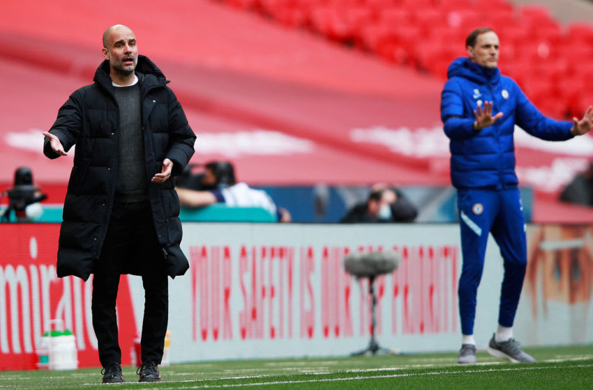 LONDON, ENGLAND - APRIL 17: Pep Guardiola, Manager of Manchester City gives his team instructions during the Semi Final of the Emirates FA Cup match between Manchester City and Chelsea FC at Wembley Stadium on April 17, 2021 in London, England. Sporting stadiums around the UK remain under strict restrictions due to the Coronavirus Pandemic as Government social distancing laws prohibit fans inside venues resulting in games being played behind closed doors. (Photo by Ian Walton - Pool/Getty Images)