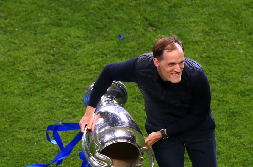 PORTO, PORTUGAL - MAY 29: Chelsea Manager Thomas Tuchel lifts the Champions League trophy after the UEFA Champions League Final between Manchester City and Chelsea FC at Estadio do Dragao on May 29, 2021 in Porto, Portugal. (Photo by Alex Livesey - Danehouse/Getty Images)