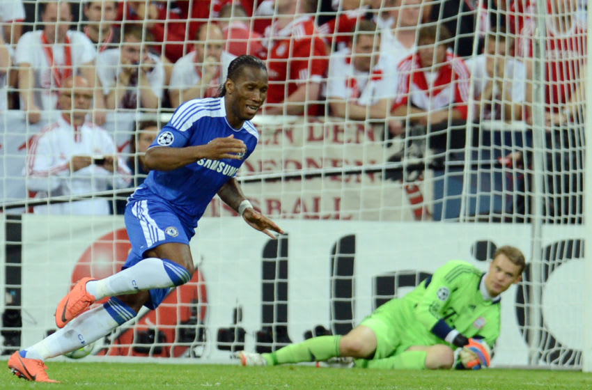 Chelsea's Ivorian forward Didier Drogba (L) celebrates as Bayern Munich's German goalkeeper Manuel Neuer looks on after scoring the last penalty in the UEFA Champions League final football match between FC Bayern Muenchen and Chelsea FC on May 19, 2012 at the Fussball Arena stadium in Munich. Munich won the match. AFP PHOTO / PATRIK STOLLARZ (Photo credit should read PATRIK STOLLARZ/AFP/GettyImages)