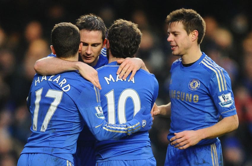 LONDON, ENGLAND - FEBRUARY 09: Frank Lampard of Chelsea celebrates the third goal with Eden Hazard and Juan Mata during the Barclays Premier League match between Chelsea and Wigan Athletic at Stamford Bridge on February 9, 2013 in London, England. (Photo by Laurence Griffiths/Getty Images)