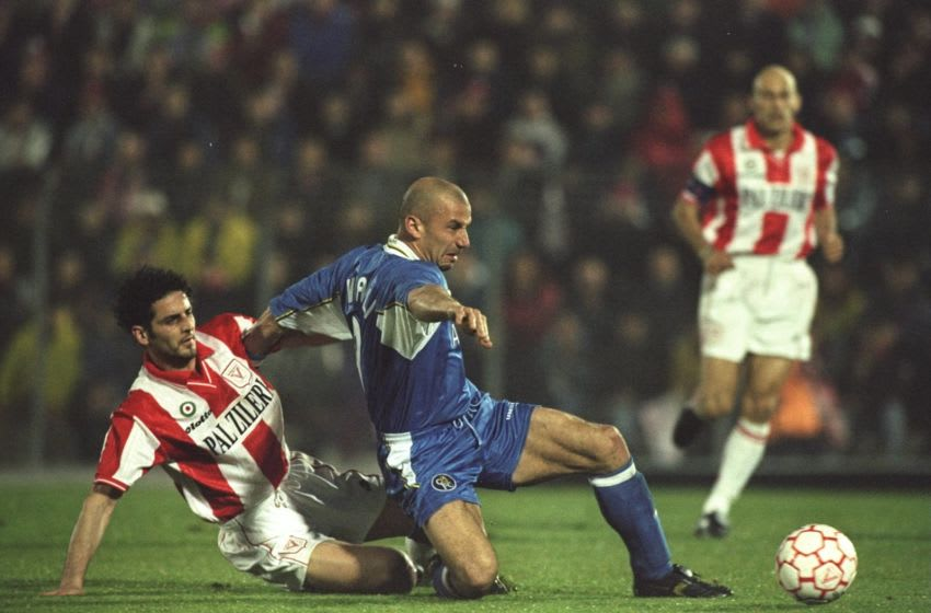 2 Apr 1998: GianLuca Vialli of Chelsea fends off a tackle from a Vicenza player during the European Cup Winners Cup semi-final between Vicenza and Chelsea played at the Mandatory Credit: Ben Radford /Allsport
