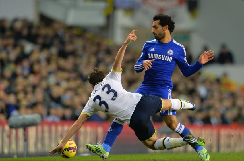 Tottenham Hotspur's Welsh defender Ben Davies (L) vies with Chelsea's Egyptian midfielder Mohamed Salah (R) during the English Premier League football match between Tottenham Hotspur and Chelsea at White Hart Lane in London on January 1, 2015. Tottenham won the game 5-3. AFP PHOTO / GLYN KIRK == RESTRICTED TO EDITORIAL USE. NO USE WITH UNAUTHORIZED AUDIO, VIDEO, DATA, FIXTURE LISTS, CLUB/LEAGUE LOGOS OR LIVE SERVICES. ONLINE IN-MATCH USE LIMITED TO 45 IMAGES, NO VIDEO EMULATION. NO USE IN BETTING, GAMES OR SINGLE CLUB/LEAGUE/PLAYER PUBLICATIONS. == (Photo credit should read GLYN KIRK/AFP via Getty Images)