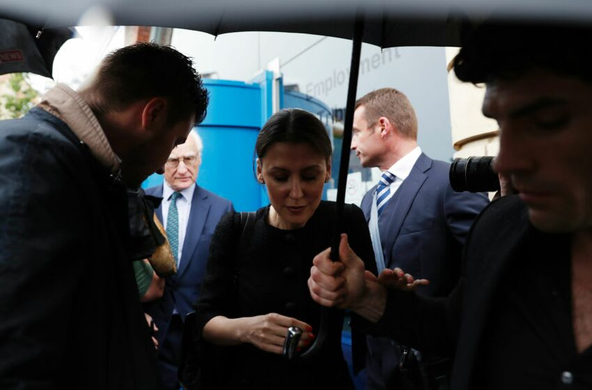 Chelsea board member Marina Granovskaia (C) and Chelsea's US chairman Bruce Buck (back L) are surrounded by media as they leave Croydon Employment Tribunal in Croydon, south London, on June 7, 2016 after a private settlement was reached in former Chelsea Football Club doctor Eva Carneiro's claim against Chelsea and Mourinho. Former Chelsea doctor Eva Carneiro on June 7, 2016 agreed a deal to settle a case against the football club and Manchester United manager Jose Mourinho for an undisclosed sum. Carneiro was claiming constructive dismissal against Chelsea and was persuing a separate, but connected, personal legal action against Mourinho, who left the club in December, for alleged victimisation and discrimination. The confidential settlement was made on the second day of the tribunal. / AFP / ADRIAN DENNIS (Photo credit should read ADRIAN DENNIS/AFP via Getty Images)