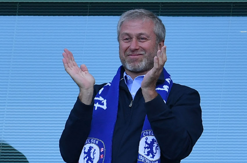 Chelsea's Russian owner Roman Abramovich applauds, as players celebrate their league title win at the end of the Premier League football match between Chelsea and Sunderland at Stamford Bridge in London on May 21, 2017. Chelsea's extended victory parade reached a climax with the trophy presentation on May 21, 2017 after being crowned Premier League champions with two games to go. / AFP PHOTO / Ben STANSALL / RESTRICTED TO EDITORIAL USE. No use with unauthorized audio, video, data, fixture lists, club/league logos or 'live' services. Online in-match use limited to 75 images, no video emulation. No use in betting, games or single club/league/player publications. / (Photo credit should read BEN STANSALL/AFP via Getty Images)