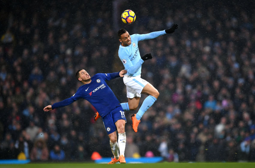 MANCHESTER, ENGLAND - MARCH 04: Danilo of Manchester City and Eden Hazard of Chelsea jump for the header during the Premier League match between Manchester City and Chelsea at Etihad Stadium on March 4, 2018 in Manchester, England. (Photo by Laurence Griffiths/Getty Images)