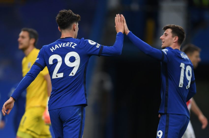 Chelsea's German midfielder Kai Havertz is congratulated by Chelsea's English midfielder Mason Mount after scoring during the English Premier League football match between Chelsea and Southampton at Stamford Bridge in London on October 17, 2020. (Photo by Mike Hewitt / POOL / AFP) / RESTRICTED TO EDITORIAL USE. No use with unauthorized audio, video, data, fixture lists, club/league logos or 'live' services. Online in-match use limited to 120 images. An additional 40 images may be used in extra time. No video emulation. Social media in-match use limited to 120 images. An additional 40 images may be used in extra time. No use in betting publications, games or single club/league/player publications. / (Photo by MIKE HEWITT/POOL/AFP via Getty Images)