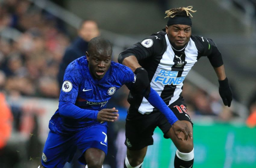 Chelsea's French midfielder N'Golo Kante (L) vies with Newcastle United's French midfielder Allan Saint-Maximin during the English Premier League football match between Newcastle United and Chelsea at St James' Park in Newcastle-upon-Tyne, north east England on January 18, 2020. (Photo by Lindsey Parnaby / AFP) / RESTRICTED TO EDITORIAL USE. No use with unauthorized audio, video, data, fixture lists, club/league logos or 'live' services. Online in-match use limited to 120 images. An additional 40 images may be used in extra time. No video emulation. Social media in-match use limited to 120 images. An additional 40 images may be used in extra time. No use in betting publications, games or single club/league/player publications. / (Photo by LINDSEY PARNABY/AFP via Getty Images)