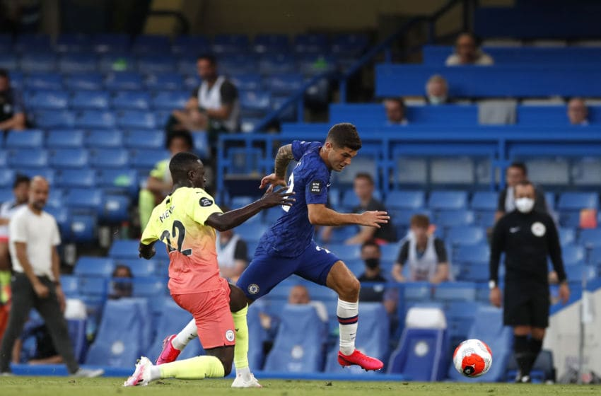 LONDON, ENGLAND - JUNE 25: Christian Pulisic of Chelsea runs with the ball past Benjamin Mendy of Manchester City before scoring his team's first goal during the Premier League match between Chelsea FC and Manchester City at Stamford Bridge on June 25, 2020 in London, United Kingdom. (Photo by Paul Childs/Pool via Getty Images)