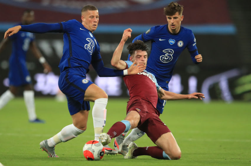 and Chelsea's English midfielder Mason Mount vies with Chelsea's English midfielder Ross Barkley West Ham United's English midfielder Declan Rice during the English Premier League football match between West Ham United and Chelsea at The London Stadium, in east London on July 1, 2020. (Photo by Adam Davy / POOL / AFP) / RESTRICTED TO EDITORIAL USE. No use with unauthorized audio, video, data, fixture lists, club/league logos or 'live' services. Online in-match use limited to 120 images. An additional 40 images may be used in extra time. No video emulation. Social media in-match use limited to 120 images. An additional 40 images may be used in extra time. No use in betting publications, games or single club/league/player publications. / (Photo by ADAM DAVY/POOL/AFP via Getty Images)