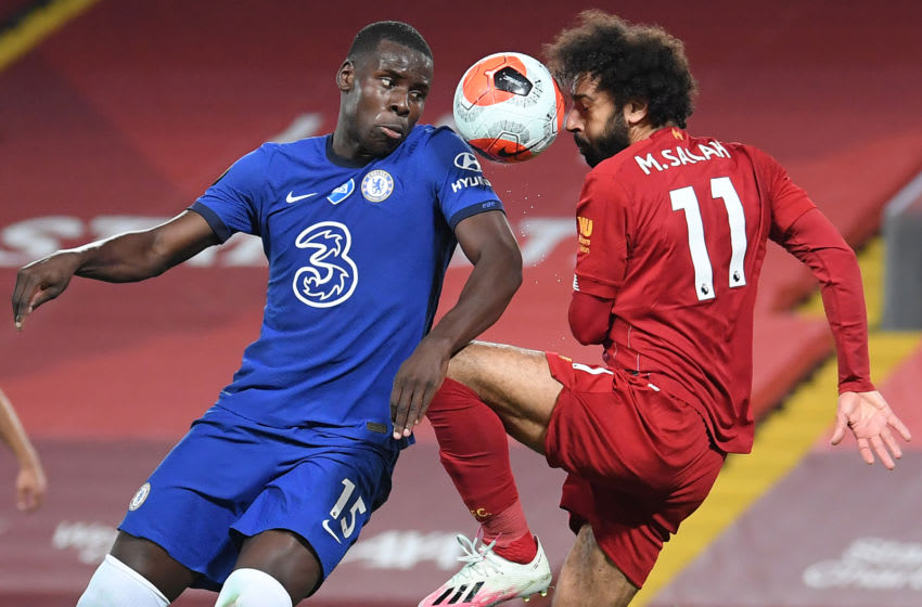 Chelsea's French defender Kurt Zouma (L) vies with Liverpool's Egyptian midfielder Mohamed Salah during the English Premier League football match between Liverpool and Chelsea at Anfield in Liverpool, north west England on July 22, 2020. (Photo by Laurence Griffiths / POOL / AFP) / RESTRICTED TO EDITORIAL USE. No use with unauthorized audio, video, data, fixture lists, club/league logos or 'live' services. Online in-match use limited to 120 images. An additional 40 images may be used in extra time. No video emulation. Social media in-match use limited to 120 images. An additional 40 images may be used in extra time. No use in betting publications, games or single club/league/player publications. / (Photo by LAURENCE GRIFFITHS/POOL/AFP via Getty Images)