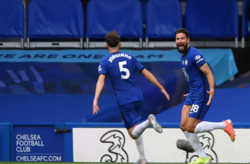 Chelsea's French striker Olivier Giroud (R) celebrates with Chelsea's Italian midfielder Jorginho after scoring during the English Premier League football match between Chelsea and Wolverhampton Wanderers at Stamford Bridge in London on July 26, 2020. (Photo by Mike Hewitt / POOL / AFP) / RESTRICTED TO EDITORIAL USE. No use with unauthorized audio, video, data, fixture lists, club/league logos or 'live' services. Online in-match use limited to 120 images. An additional 40 images may be used in extra time. No video emulation. Social media in-match use limited to 120 images. An additional 40 images may be used in extra time. No use in betting publications, games or single club/league/player publications. / (Photo by MIKE HEWITT/POOL/AFP via Getty Images)