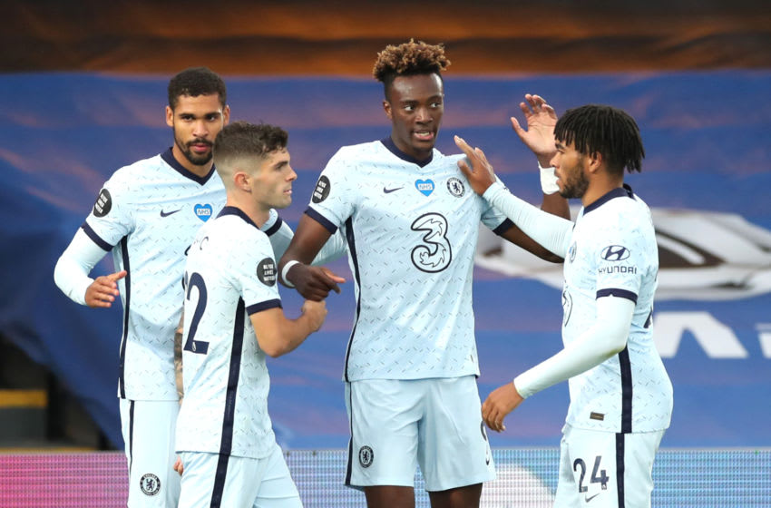 LONDON, ENGLAND - JULY 07: Tammy Abraham of Chelsea celebrates with teammates after scoring his team's third goal during the Premier League match between Crystal Palace and Chelsea FC at Selhurst Park on July 07, 2020 in London, England. Football Stadiums around Europe remain empty due to the Coronavirus Pandemic as Government social distancing laws prohibit fans inside venues resulting in all fixtures being played behind closed doors. (Photo by Peter Cziborra/Pool via Getty Images)