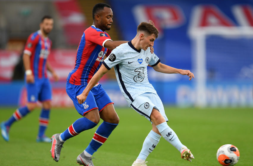 LONDON, ENGLAND - JULY 07: Billy Gilmour of Chelsea holds off Jordan Ayew of Crystal Palace during the Premier League match between Crystal Palace and Chelsea FC at Selhurst Park on July 07, 2020 in London, England. (Photo by Justin Setterfield/Getty Images)