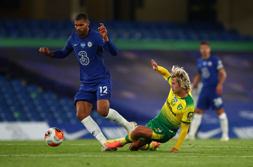 LONDON, ENGLAND - JULY 14: Todd Cantwell of Norwich City tackles Ruben Loftus-Cheek of Chelsea during the Premier League match between Chelsea FC and Norwich City at Stamford Bridge on July 14, 2020 in London, England. Football Stadiums around Europe remain empty due to the Coronavirus Pandemic as Government social distancing laws prohibit fans inside venues resulting in all fixtures being played behind closed doors. (Photo by Marc Atkins/Getty Images)