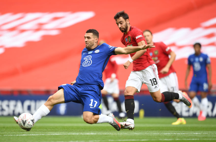 LONDON, ENGLAND - JULY 19: Mateo Kovacic of Chelsea controls the ball as Bruno Fernandes of Manchester United looks on during the FA Cup Semi Final match between Manchester United and Chelsea at Wembley Stadium on July 19, 2020 in London, England. Football Stadiums around Europe remain empty due to the Coronavirus Pandemic as Government social distancing laws prohibit fans inside venues resulting in all fixtures being played behind closed doors. (Photo by Andy Rain/Pool via Getty Images)