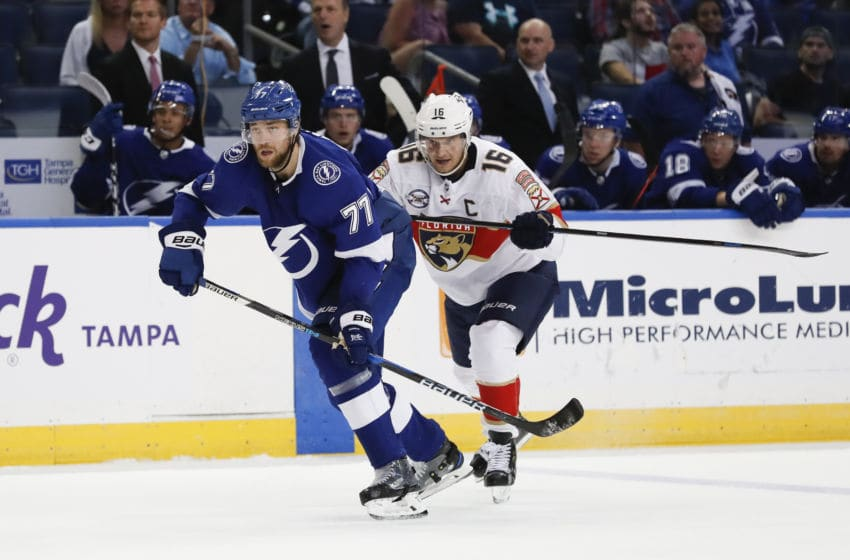 TAMPA, FL - SEPTEMBER 25: Tampa Bay Lightning defenseman Victor Hedman (77) and Florida Panthers center Aleksander Barkov (16) skate in the second period of the NHL preseason game between the Florida Panthers and Tampa Bay Lightning on September 25, 2018, at Amalie Arena in Tampa, FL. (Photo by Mark LoMoglio/Icon Sportswire via Getty Images)