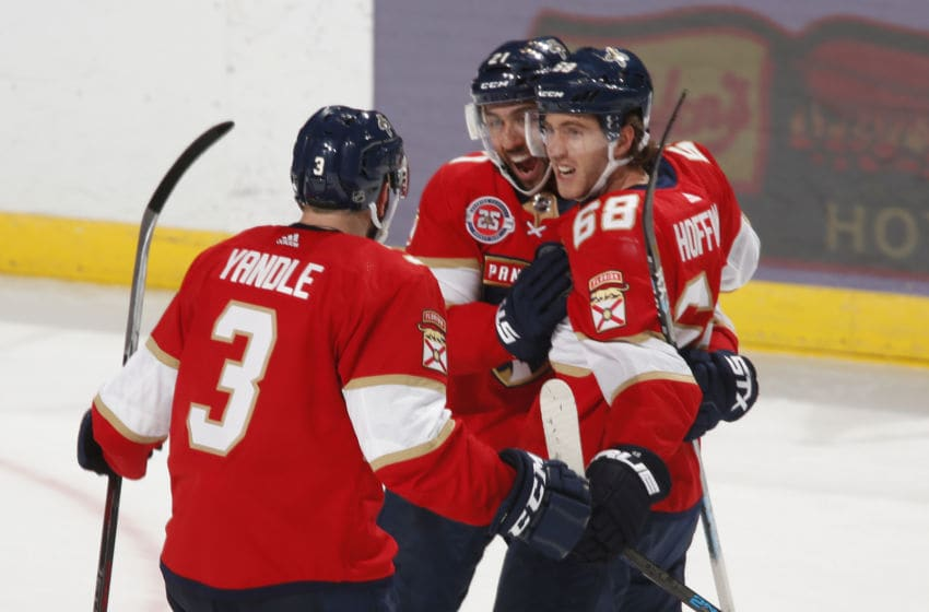 SUNRISE, FL - OCTOBER 20: Mike Hoffman #68 is congratulated by Keith Yandle #3 and Vincent Trocheck #21 of the Florida Panthers after scoring a goal to tie the game against the Detroit Red Wings in the third period at the BB&T Center on October 20, 2018 in Sunrise, Florida. The Red Wings defeated the Panthers 4-3 in overtime. (Photo by Joel Auerbach/Getty Images)