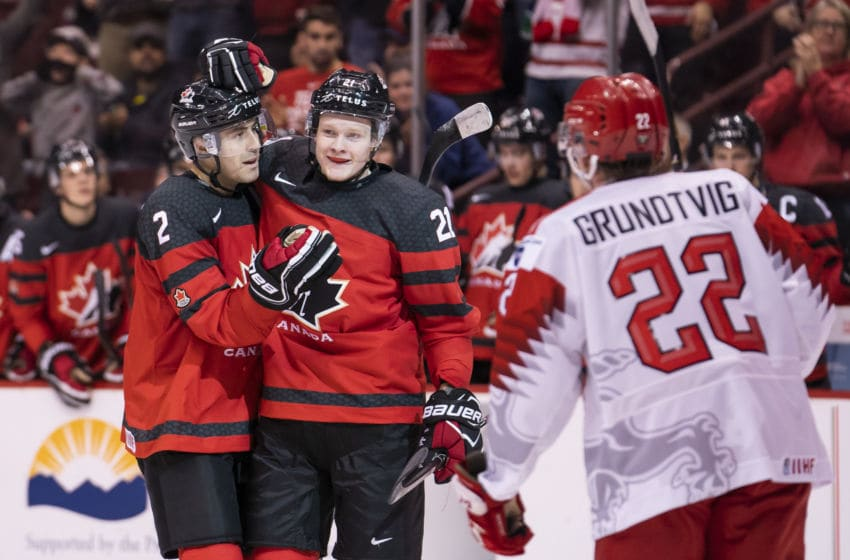 VANCOUVER, BC - DECEMBER 26: Owen Tippett #21 of Canada celebrates with teammate Evan Bouchard #2 after scoring a goal as Andreas Grundtvig #22 of Denmark skates past in Group A hockey action of the 2019 IIHF World Junior Championship action on December, 26, 2018 at Rogers Arena in Vancouver, British Columbia, Canada. (Photo by Rich Lam/Getty Images)