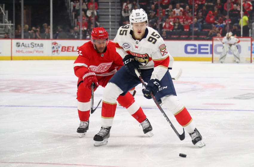 DETROIT, MICHIGAN - DECEMBER 22: Henrik Borgstrom #95 of the Florida Panthers tries to avoid the stick of Frans Nielsen #51 of the Detroit Red Wings during the first period at Little Caesars Arena on December 22, 2018 in Detroit, Michigan. (Photo by Gregory Shamus/Getty Images)