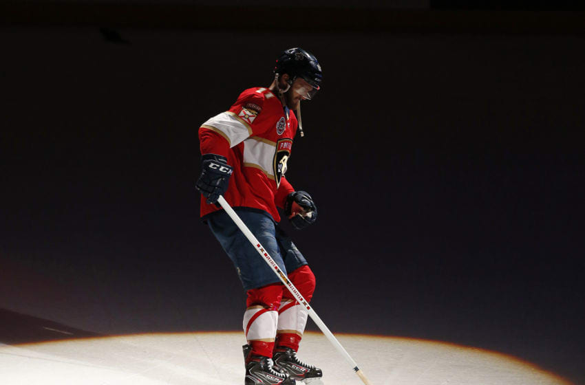 SUNRISE, FL - MARCH 21: Jonathan Huberdeau #11 of the Florida Panthers skates on the ice with a victory rat after their 4-2 win against the Arizona Coyotes at the BB&T Center on March 21, 2019 in Sunrise, Florida. (Photo by Eliot J. Schechter/NHLI via Getty Images)