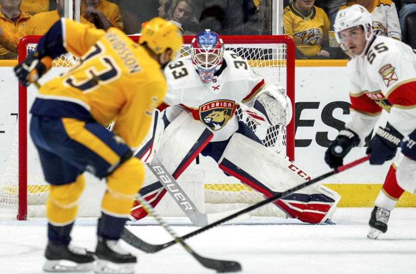 NASHVILLE, TN - OCTOBER 19: Sam Montembeault #33 of the Florida Panthers eyes the puck on the stick of Viktor Arvidsson #33 of the Nashville Predators at Bridgestone Arena on October 19, 2019 in Nashville, Tennessee. (Photo by John Russell/NHLI via Getty Images)