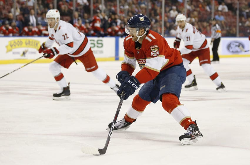 SUNRISE, FLORIDA - OCTOBER 08: Jonathan Huberdeau #11 of the Florida Panthers skates with the puck against the Carolina Hurricanes during the first period at BB&T Center on October 08, 2019 in Sunrise, Florida. (Photo by Michael Reaves/Getty Images)