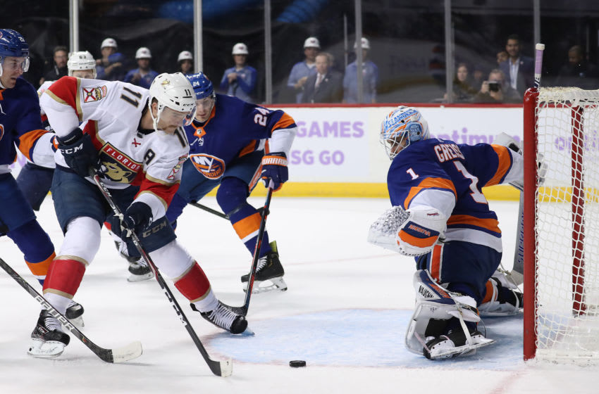 NEW YORK, NEW YORK - NOVEMBER 09: Jonathan Huberdeau #11 of the Florida Panthers shoots against Thomas Greiss #1 of the New York Islanders in the first period during their game at Barclays Center on November 09, 2019 in New York City. (Photo by Al Bello/Getty Images)