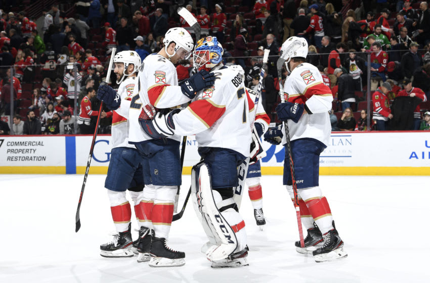 CHICAGO, IL - JANUARY 21: Josh Brown #2 and goalie Sergei Bobrovsky #72 of the Florida Panthers celebrate after defeating the Chicago Blackhawks 4-3 at the United Center on January 21, 2020 in Chicago, Illinois. (Photo by Bill Smith/NHLI via Getty Images)