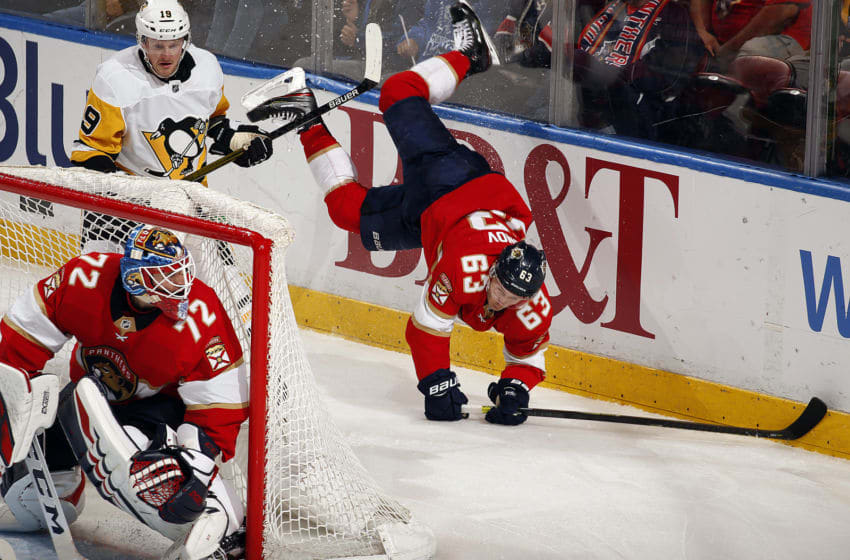 SUNRISE, FL - FEBRUARY 8: Evgeni Dadonov #63 of the Florida Panthers collides with Jared McCann #19 of the Pittsburgh Penguins at the BB&T Center on February 8, 2020 in Sunrise, Florida. (Photo by Eliot J. Schechter/NHLI via Getty Images)