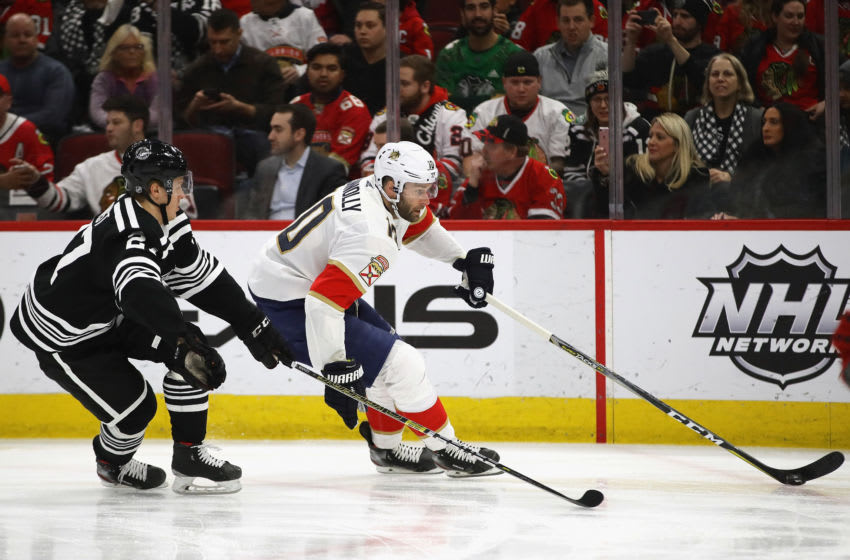 CHICAGO, ILLINOIS - JANUARY 21: Brett Connolly #10 of the Florida Panthers controls the puck in front of Adam Boqvist #27 of the Chicago Blackhawks at the United Center on January 21, 2020 in Chicago, Illinois. The Panthers defeated the Blackhawks 4-3. (Photo by Jonathan Daniel/Getty Images)