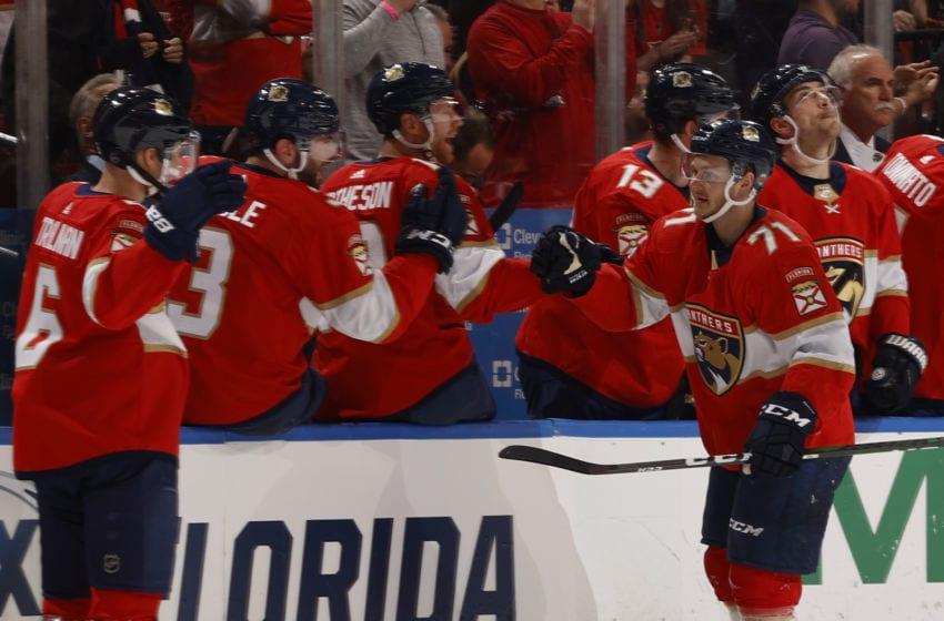 SUNRISE, FL - MARCH 7: Teammates congratulate Lucas Wallmark #71 of the Florida Panthers after he scored a second period goal against the Montreal Canadiens at the BB&T Center on March 7, 2020 in Sunrise, Florida. (Photo by Joel Auerbach/Getty Images)