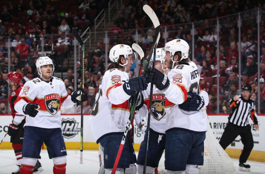 GLENDALE, ARIZONA - FEBRUARY 25: MacKenzie Weegar #52, Erik Haula #56, Frank Vatrano #77 and Mike Hoffman #68 of the Florida Panthers celebrate after Vatrano scored a goal against the Arizona Coyotes during the second period of the NHL game at Gila River Arena on February 25, 2020 in Glendale, Arizona. (Photo by Christian Petersen/Getty Images)