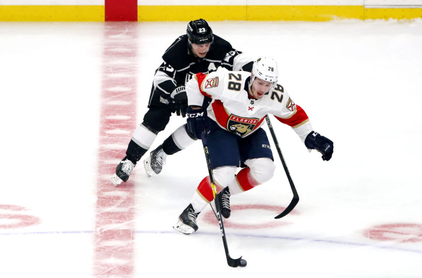 LOS ANGELES, CALIFORNIA - FEBRUARY 20: Aleksi Saarela #28 of the Florida Panthers skates against Dustin Brown #23 of the Los Angeles Kings during the game at Staples Center on February 20, 2020 in Los Angeles, California. (Photo by Katelyn Mulcahy/Getty Images)