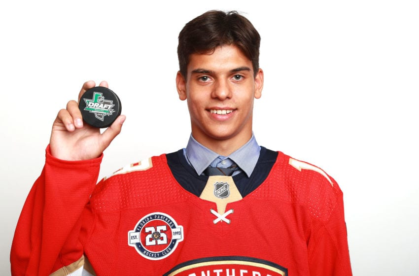DALLAS, TX - JUNE 22: Grigori Denisenko poses after being selected fifteenth overall by the Florida Panthers during the first round of the 2018 NHL Draft at American Airlines Center on June 22, 2018 in Dallas, Texas. (Photo by Tom Pennington/Getty Images)